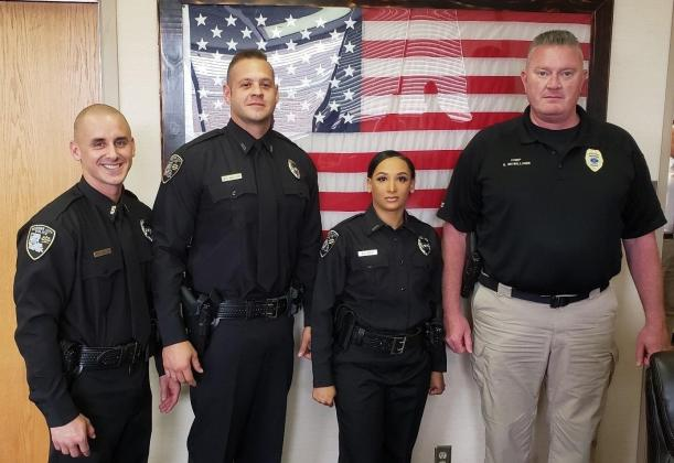Bossier City Police officers Mathew Welch, Edway Gallier, Jr., and Keandra West with Chief Shane McWilliams.