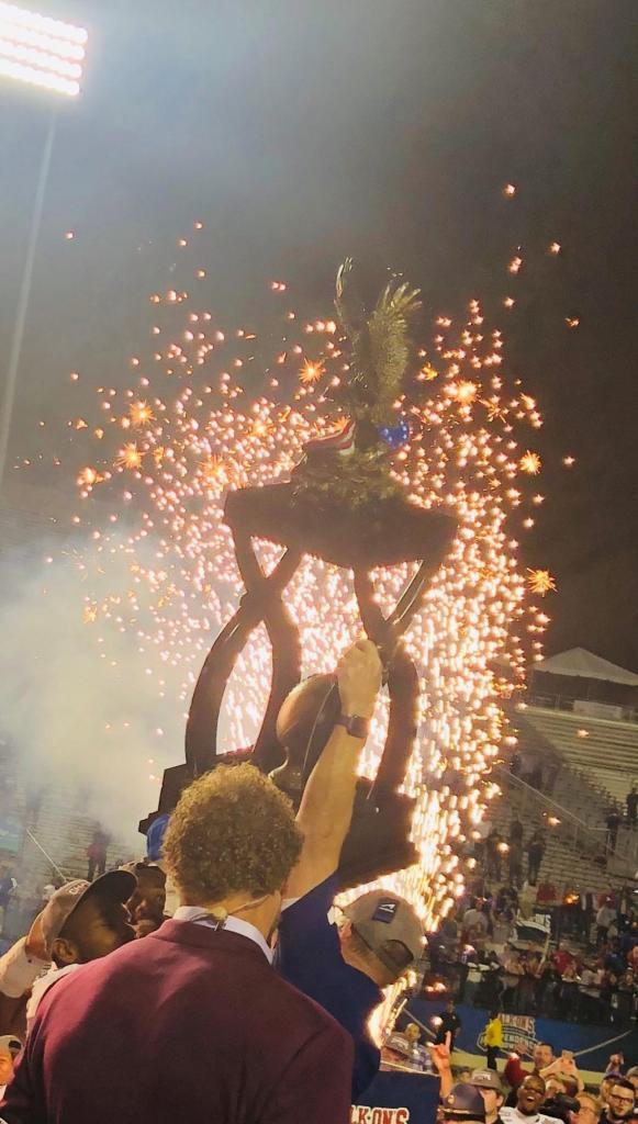 Louisiana Tech coach Skip Holtz hoists the trophy!